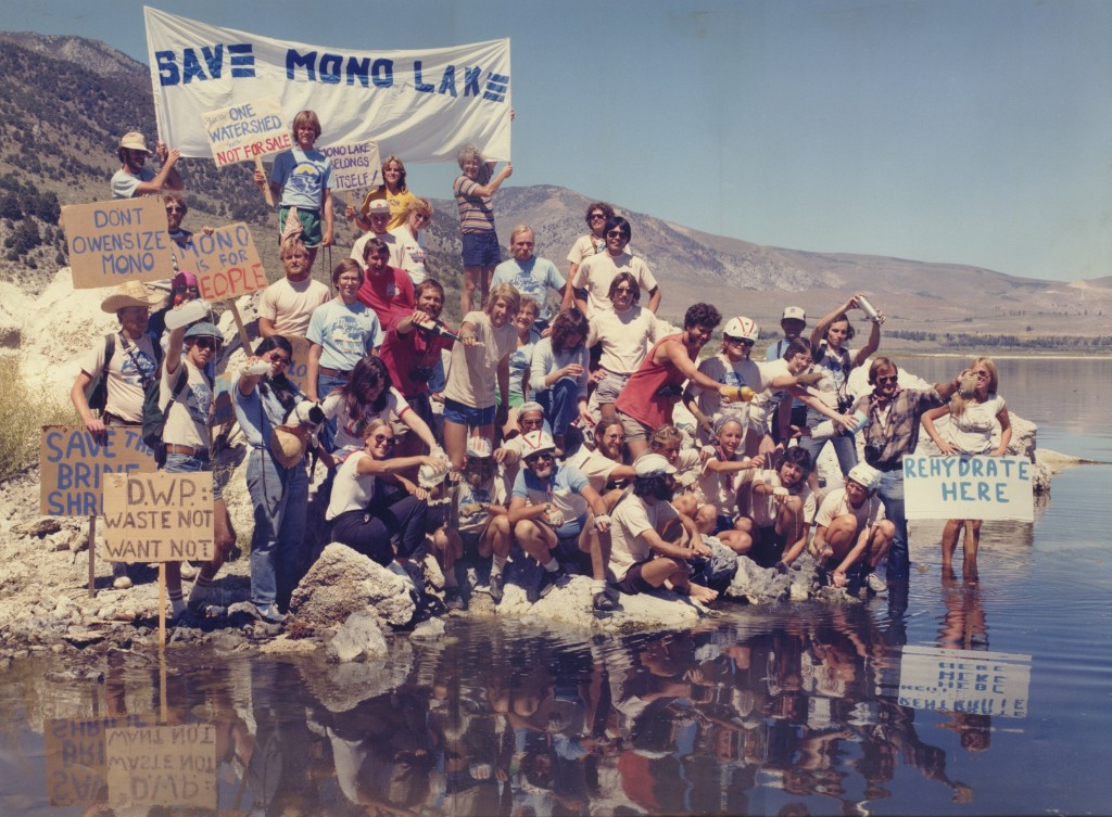 Cyclists dump water into Mono Lake at a rehdryation ceremony in 1982 -- by Stephen Johnson